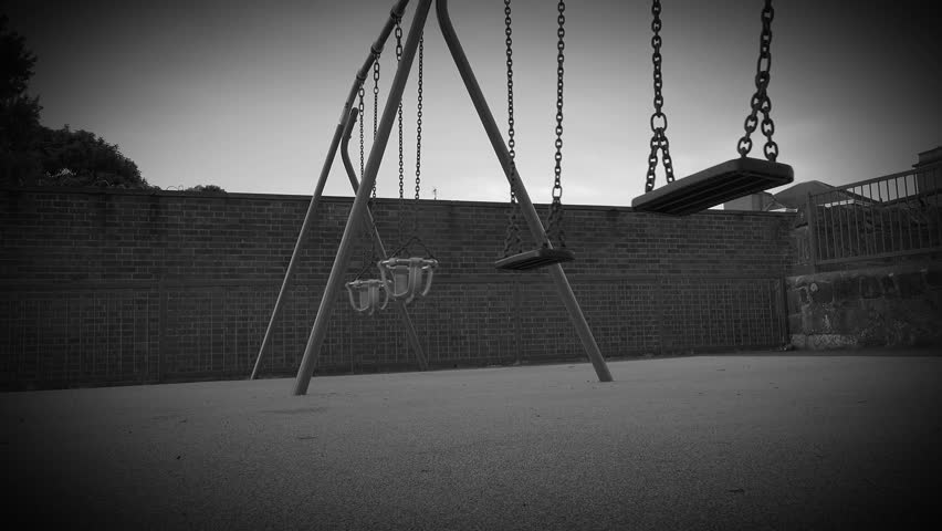 black and white creepy childs empty playground toy swings