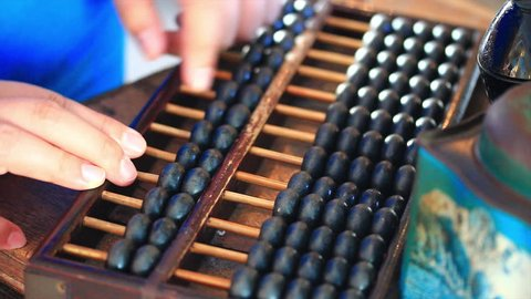 chinese abacus is a calculating tool used primarily in parts of Asia for performing arithmetic processes. The abacus was in use centuries before the adoption of the written modern numeral system