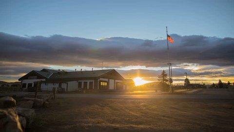 Sunrise Sunset Timelapse Over Small Town American Flag Building