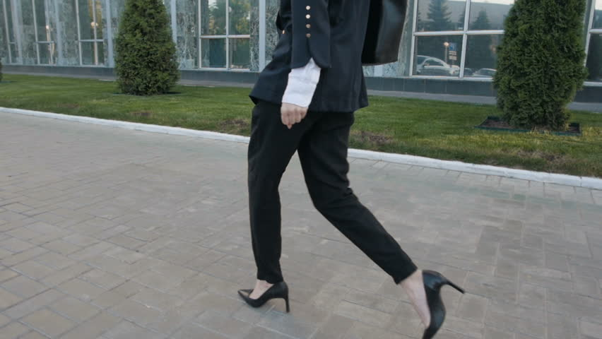 Back View of Young Business Woman Legs In High-Heeled Shoes Walking Outdoors | Shutterstock HD Video #17213143
