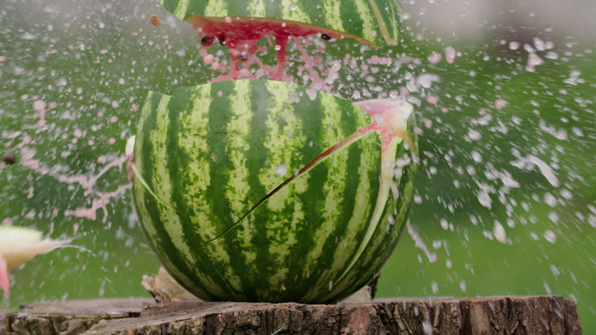 Watermelon gun shot in native slow motion scene on green background