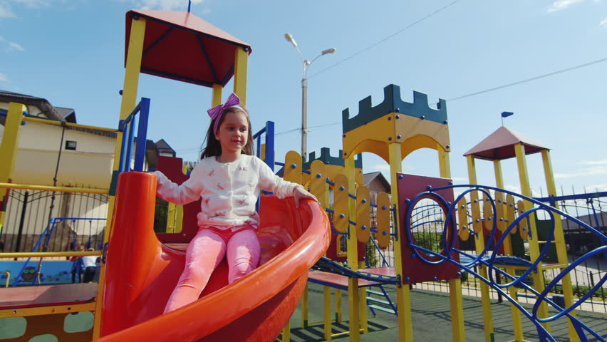f64c26cad7a6c Child Sliding On a Slide Stock Footage Video (100% Royalty-free ...