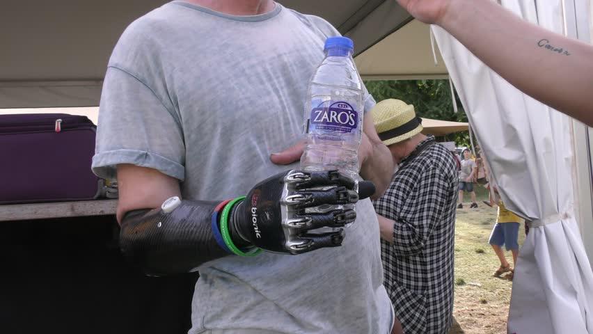 JERUSALEM, ISRAEL - APRIL 26, 2016: An amputee man demonstrates his  bionic BeBionic hand during Geek PicNic international festival