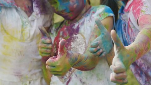 cute european child girls celebrate Indian holi festival with colorful paint