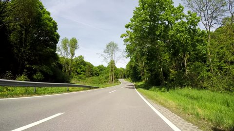 P.O.V. Video footage: Driving in nice Landscape in Germany in summer in agricultural region of the Eifel