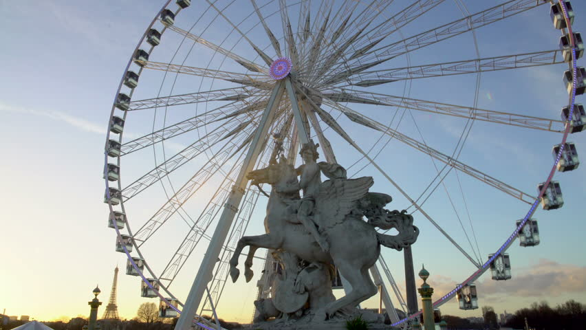 Panorama of Paris cityscape, Pegasus Equastrian statue in front of Ferris wheel