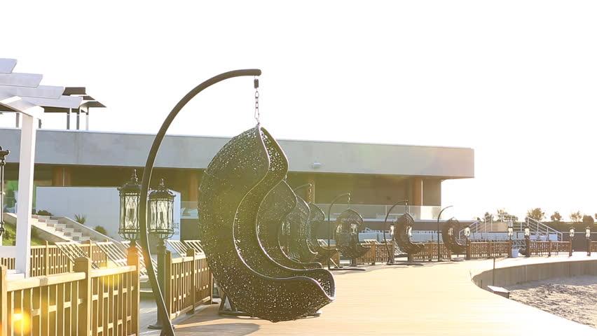 Modern Furniture Video round modern furniture plastic wicker chairs in garden. aqua park