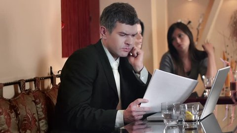 Worried businessman reading reports