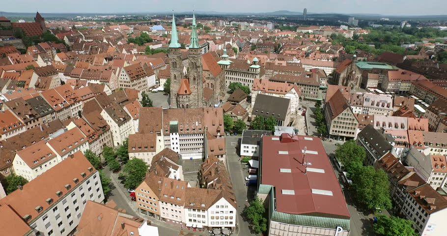 NUREMBERG, GERMANY June 6, 2016: The old city of Nuremberg is seen in an aerial shot. The camera passes by the church Sankt Sebald.