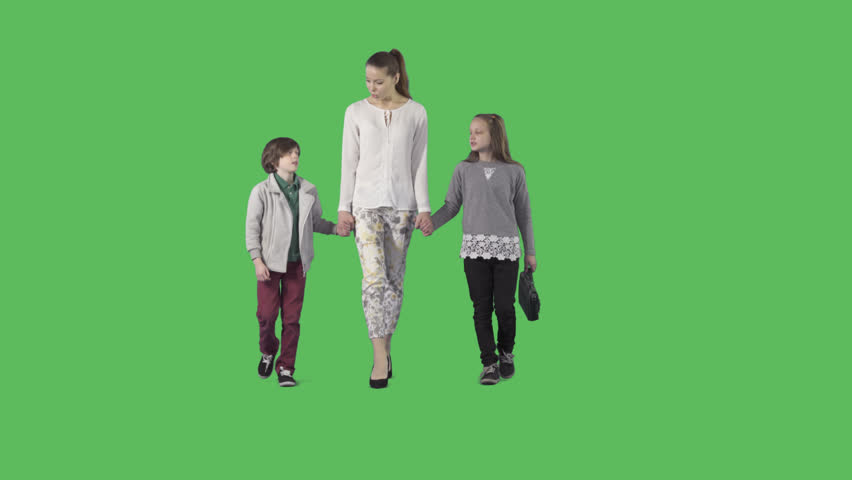 Young beautiful mother with two attractive children are walking at the camera. Camera is static. Lens 85 mm. Footage with alpha channel. File format - .mov, codec PNG+Alpha