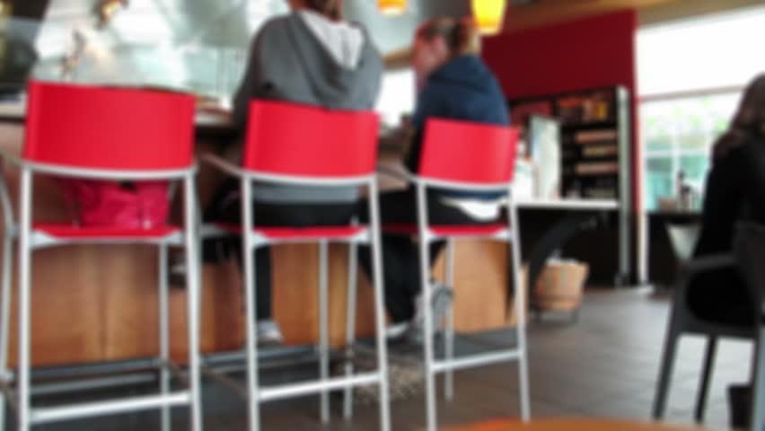 People Sitting at a Coffee Shop Defocused