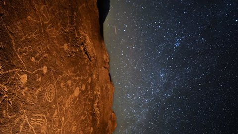 Astrophotography Time Lapse with pan motion of star trails over Native American petroglyphs in Eastern Sierra, California -Vertical Shot-