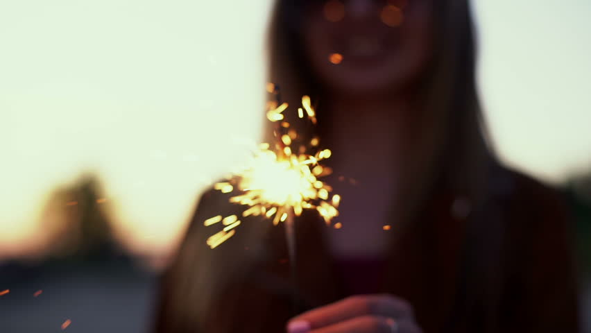 SLOW MOTION: Portrait of a girl model looks with sparklers in their hands   Shutterstock HD Video #17393863