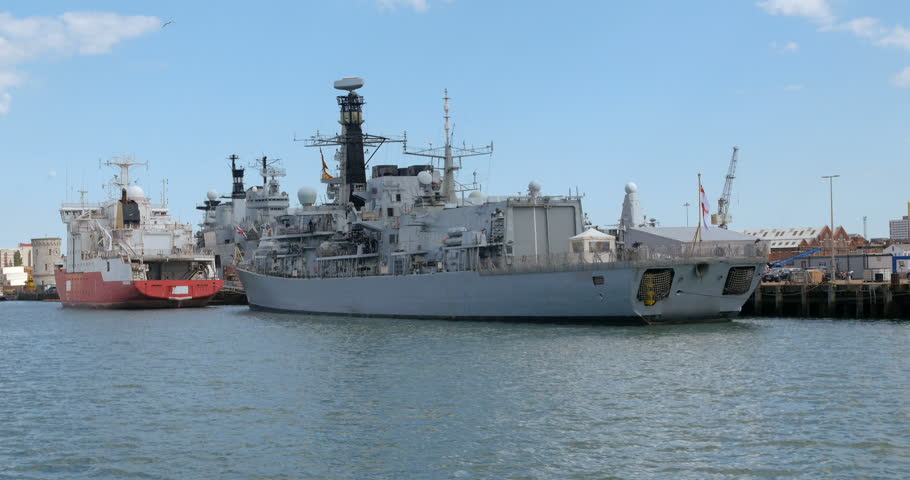 Dolly 4k view of a modern warship in Portsmouth harbour