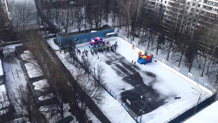 High Angle View at Hockey Field in a Courtyard With Children and Their Parents at the Pancake Festival (Maslenitsa is a Traditional Russian Holiday Celebrates Marks Arrival of Spring). Time Lapse to