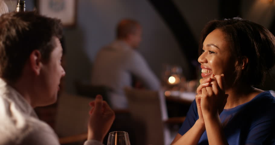 4K Waitress in a restaurant serves wine to a happy, relaxed young couple #17422633