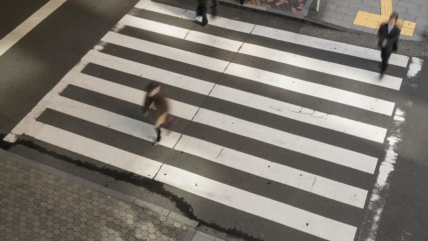TOKYO, JAPAN - JANUARY 2016 :High speed. Pedestrian crossing busy with commuters & traffic, Tokyo, Japan | Shutterstock HD Video #17431213