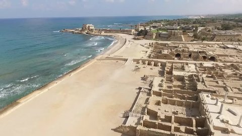 This is an aerial views of  Caesarea Harbor National Park and the Mediterranean Sea along the coast of Israel. In this video you can see The City walls, moat and Port