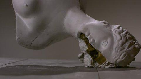 Statue drop down slow motion