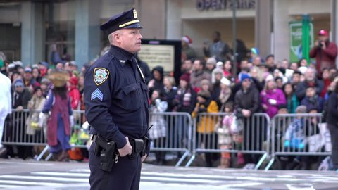 NEW YORK CITY, NY - NOVEMBER 26 : New York City Police Officer standing along parade route of Macy's 89th Annual Thanksgiving Day Parade on November 26, 2015 in New York City, New York.