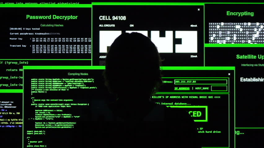 Cyber hacker sits and examines data. Multiple windows display hacking information to break into secured systems to steal money from bank or control the world. Nobody is safe.