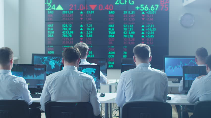 Group of Stockbrockers Celebrating Success at Stock Exchange. Shot on RED Cinema Camera in 4K (UHD).