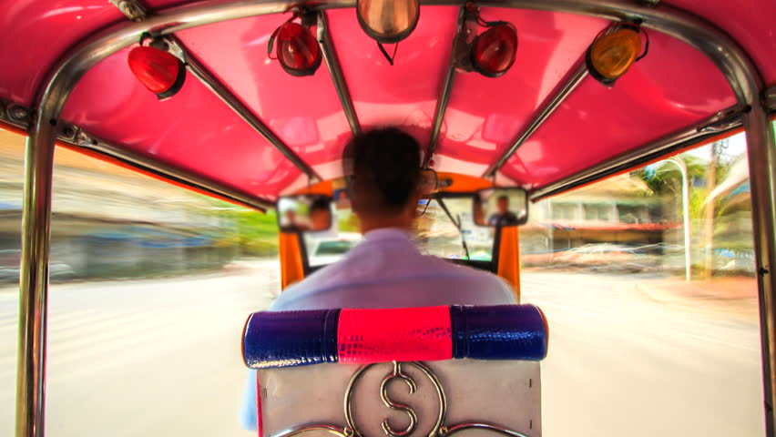 Time lapse  Time Lapse of a Speeding  tricycle  on the busy streets of Bangkok City motion bluron tricycle or tuk -tuk in Bangkok Thailand