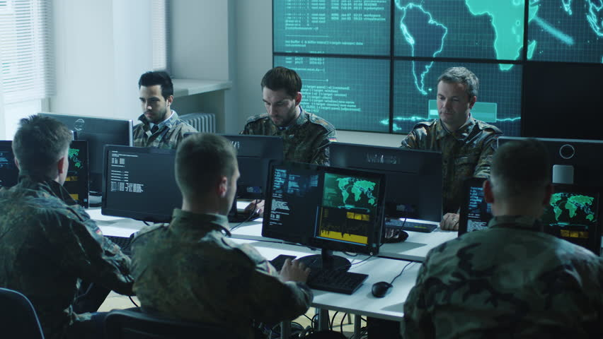 Group of Military IT Professionals on Briefing in Monitoring Room on Military Base. Shot on RED Cinema Camera in 4K (UHD).