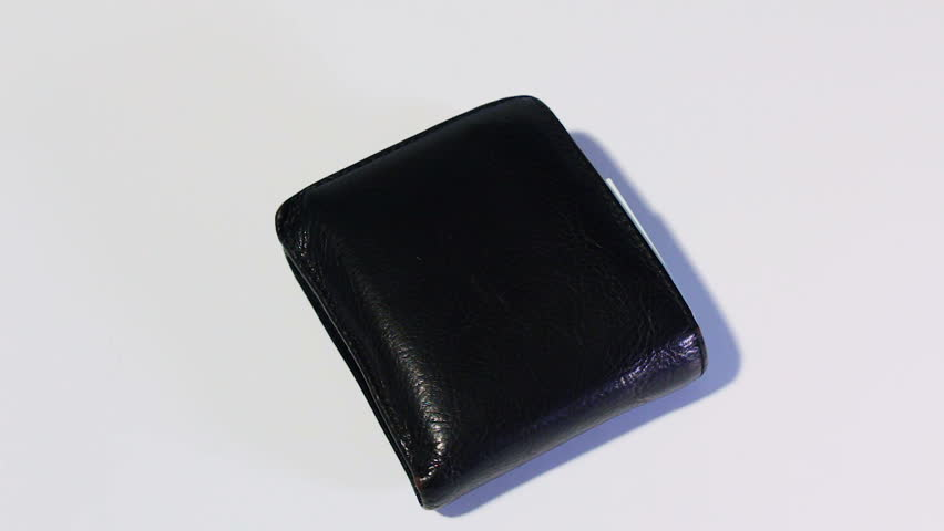 Rotating various of israeli shekel money bills in close black leather wallet - top view