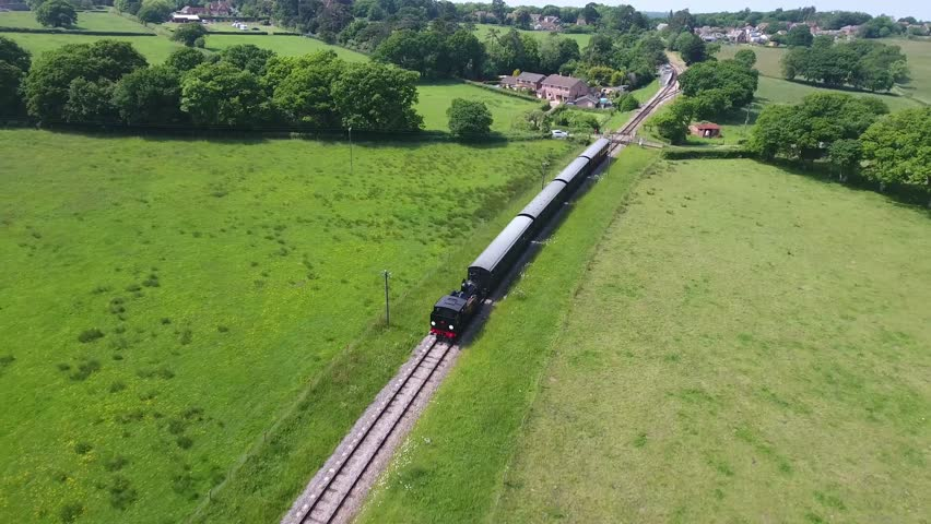 England Isle of Wight Aerial View Historic Steam Railway, from Wootton Sation to Smallbrook Sation trough Countryside Landscape including Tracks und locomotive