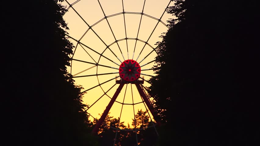 Big Ferris Wheel In Silhouette At Sunset. Sky Coloured ...