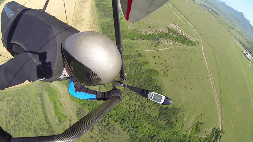 Man flying on a sport topless hang-glider