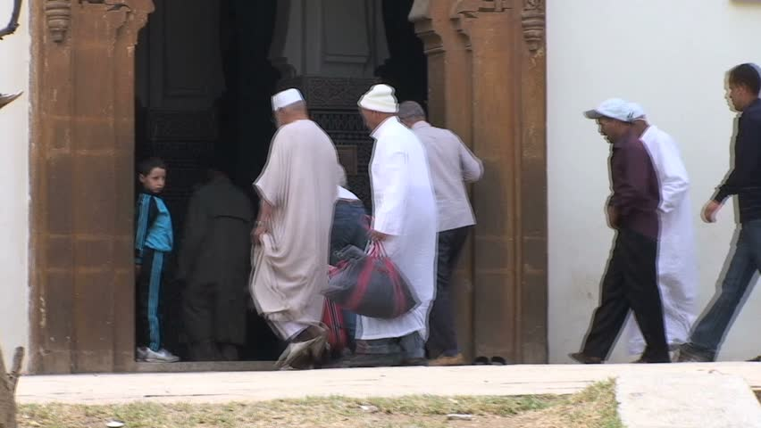 MOROCCO - CIRCA MARCH 2011: People remove their shoes and enter a place of worship circa March 2011 in Morocco.