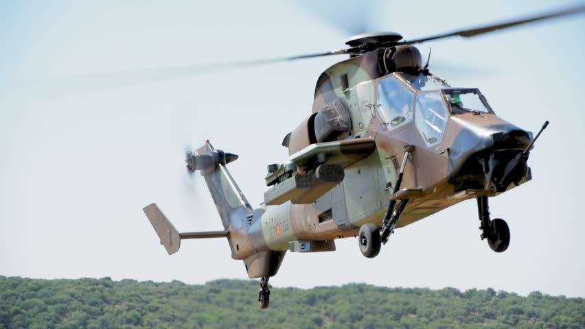 MADRID, SPAIN - JUNE 23, 2016: A fully armed Spanish Army Eurocopter Tiger helicopter approaches fast and lands on open field (part of 50th anniversary of the unit). With ambient sound. ProRes HQ