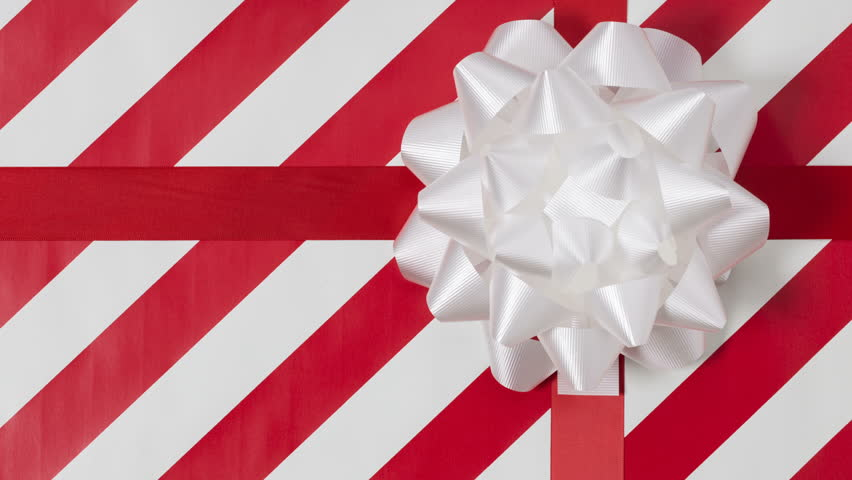 A stop motion video of Christmas gift paper being torn away revealing a green screen. | Shutterstock HD Video #17671573