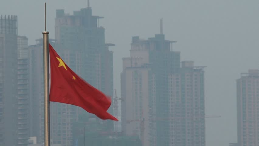 the Chinese flag flying against skyline