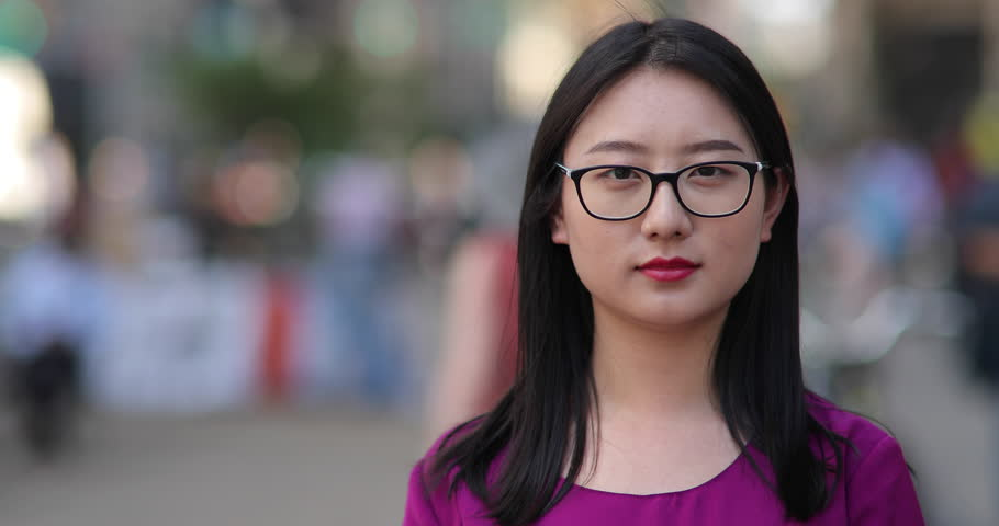 Young Asian woman in city serious face portrait | Shutterstock HD Video #17699833