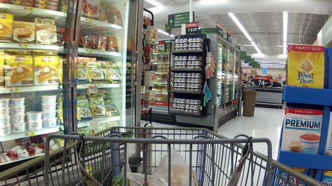 EPHRAM, UT - DEC 13 - Consumers purchase goods at Walmart during the busy holiday season December 13, 2011 in Ephram, Utah.
