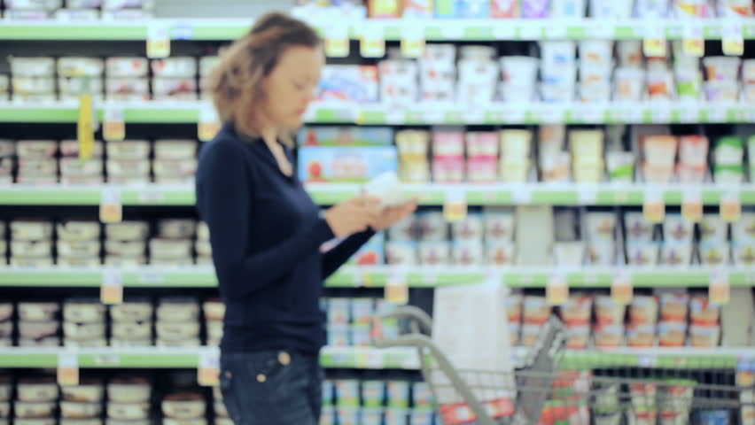 Young woman shopping in the yogurt section at the grocery store. | Shutterstock HD Video #17725921
