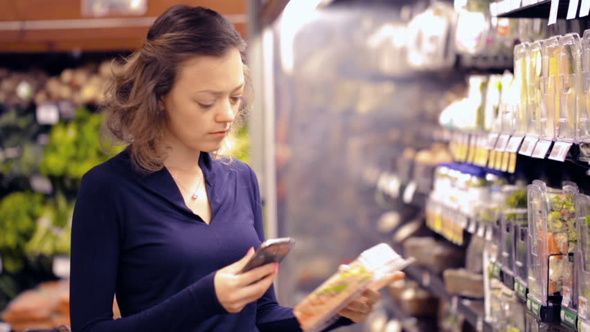 Young woman shopping in the fresh produce section at the grocery store. | Shutterstock HD Video #17725963