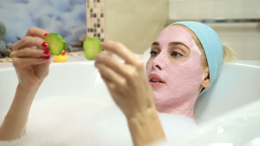 A woman takes a bath with cosmetic mask on her face. Cosmetic procedures and Recreation | Shutterstock HD Video #17738473