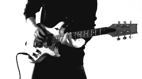 Isolated guitar player in closeup, stylized shot, black and white, white background, timbered instrument