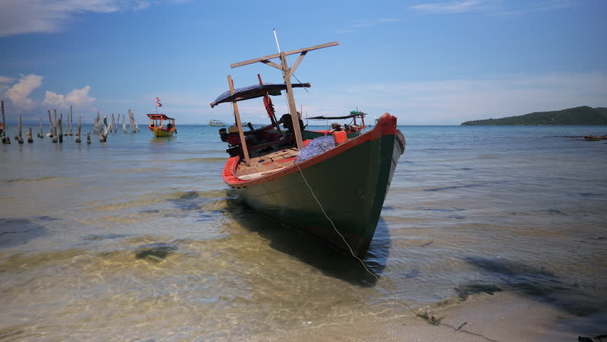 Small traditional fishing boat tied at the beach under clear blue sky ( close up ) #17752783