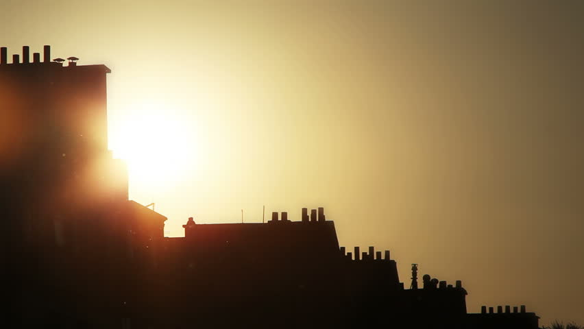 Sun setting over the mansard rooftops of Paris France | Shutterstock HD Video #1776293