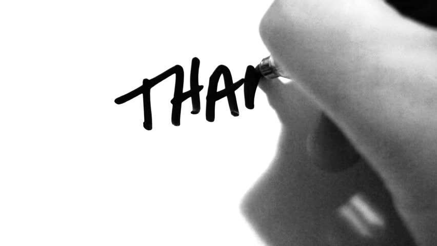 Writing thank you on white