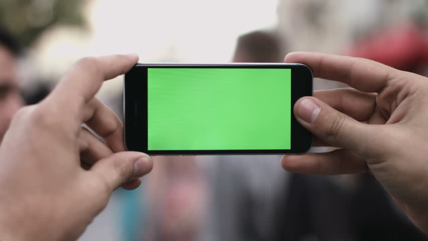 Smart Phone Held by Hand Green screen Chroma Key Tracking Motion Horizontal. Person Sitting Telephone on the Hand Swipe Down-Up Animation Type Zoom.
