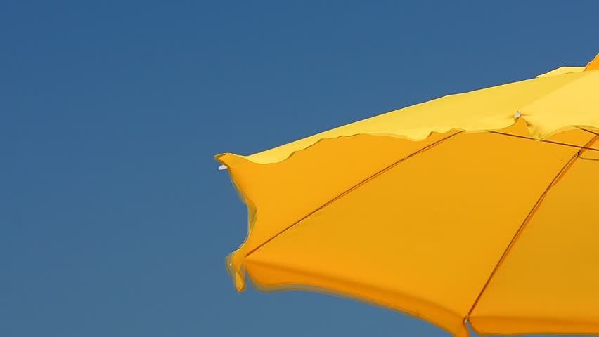 The yellow umbrella for the sun and the wind.