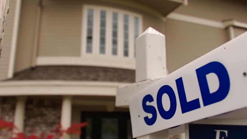 Sold sign in front of a modern home