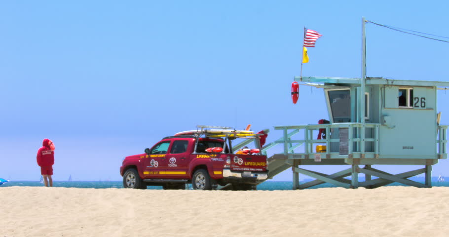 LOS ANGELES, CALIFORNIA, USA - JULY 3, 2016: Lifeguard truck on duty during the heat wave, heat distortion on purpose on July 3, 2016 in Santa Monica, Los Angeles, California, 4K, from RAW, EDITORIAL