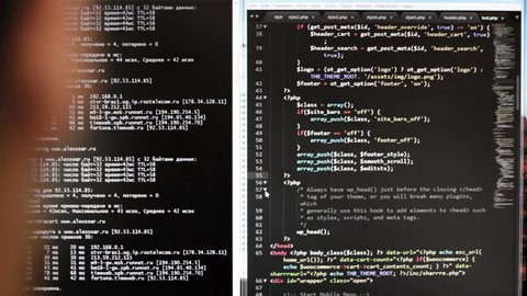 The programmer at work. The code of the website on the computer monitor. (programming code is my own property there is no possible trademark or copyright infringement)